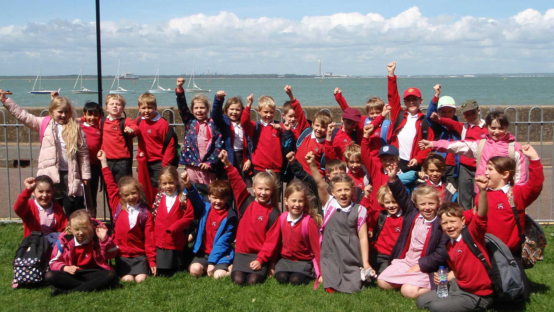 Children cheering on an Isle of Wight school trip